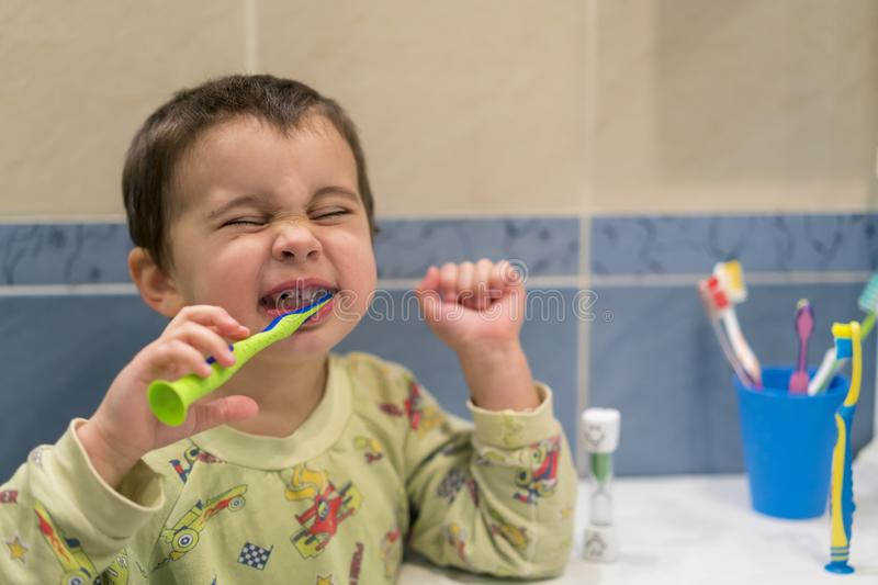 Cute little boy brushing teeth. little baby boy with tooth brush royalty free stock image