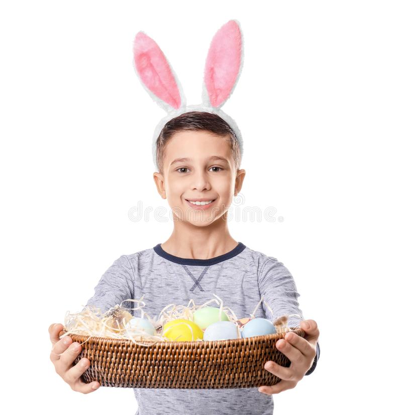 Cute little boy with bunny ears and Easter eggs on white background royalty free stock photo