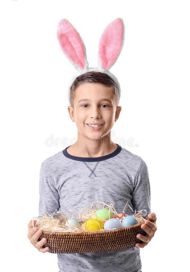 Cute little boy with bunny ears and Easter eggs on white background royalty free stock photography