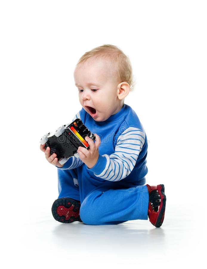 Little Boy With Toy Car : Cute little boy with the car toy royalty free stock images
