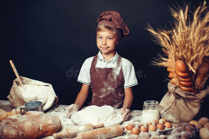 Cute little boy with chef hat cooking royalty free stock photo