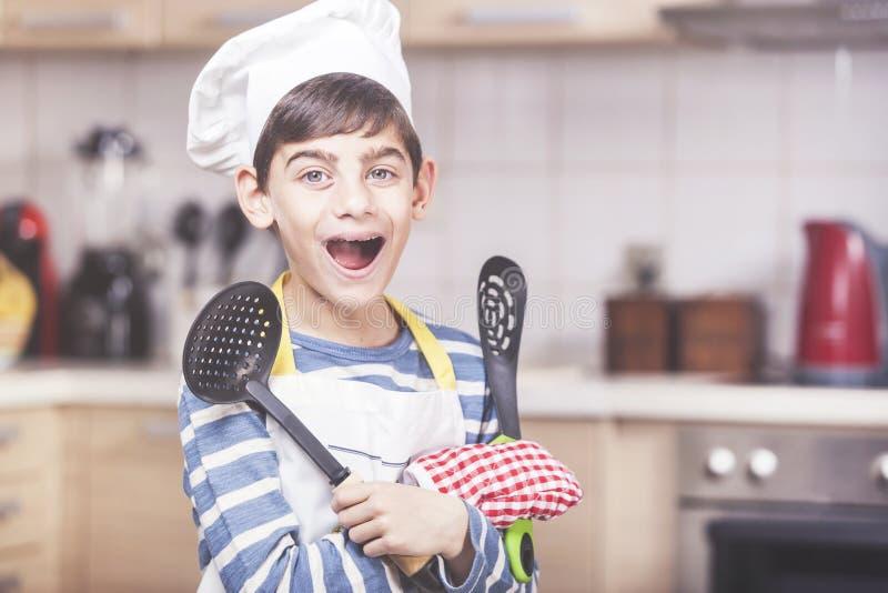 Happy little boy chef royalty free stock photo