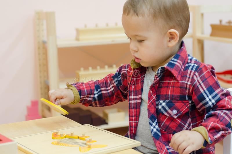 Cute little boy in the classroom early development. stock photos