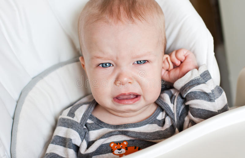 Cute little boy crying holding his ear royalty free stock photos