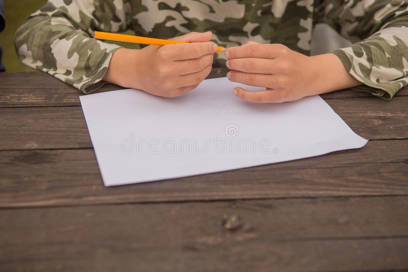 Cute little boy drawing at home. Children`s creativity. Creative kid painting at preschool. Development and education concept.Happ stock photos