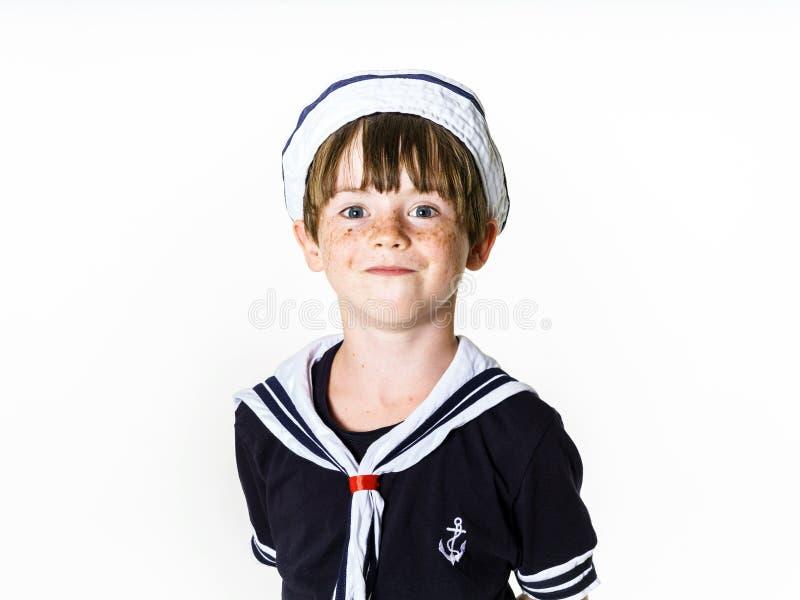 Cute little boy dressed in sailor suit stock photo