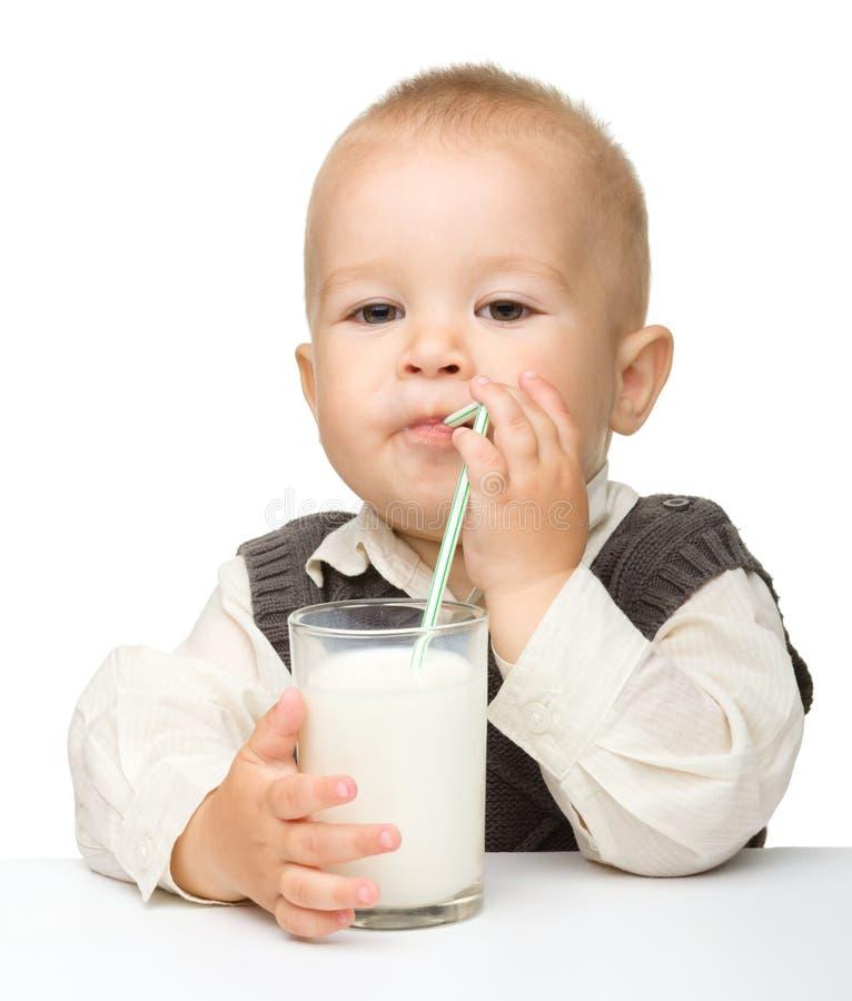 Cute Little Boy Is Drinking Milk Royalty Free Stock Photo