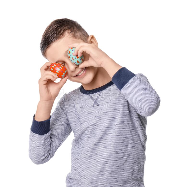 Cute little boy with Easter eggs on white background stock photos