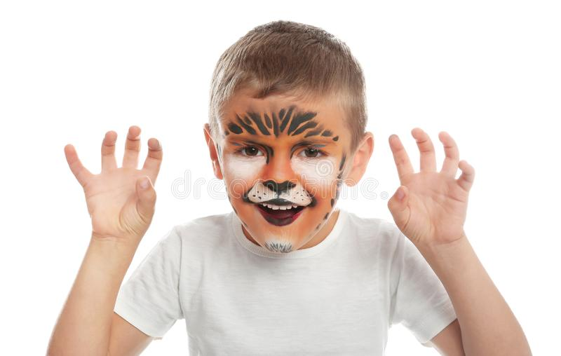 Cute little boy with face painting on white stock photo