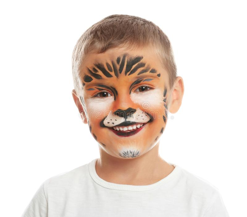 Cute little boy with face painting on white. Background royalty free stock images
