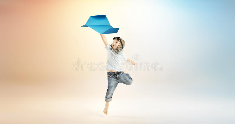 Cute little boy flying with the paper plane stock image