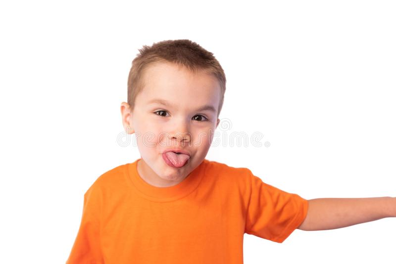 Cute little boy funny shows tongue isolated on white background royalty free stock images