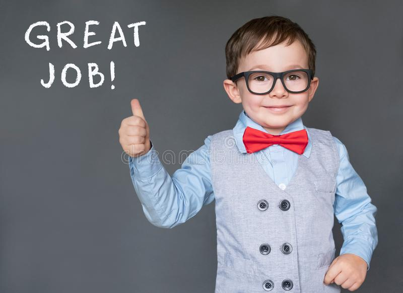 Cute little boy giving thumbs up saying Great Job royalty free stock photo