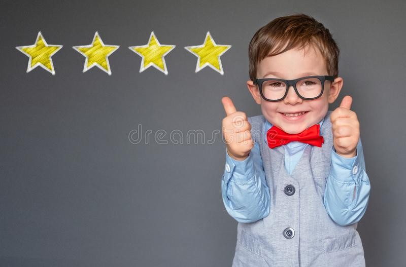 Cute little boy giving thumbs up stock photography
