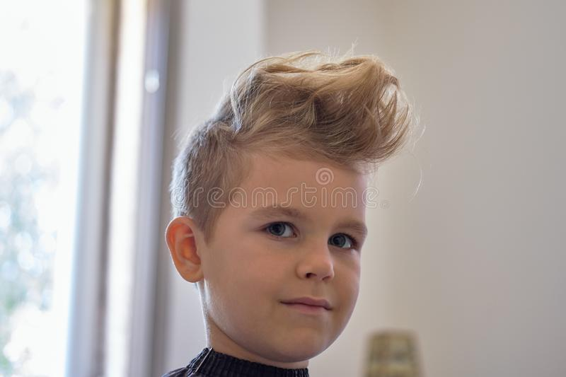 Cute Little Boy With Hairstyle, Sitting At Home Stock Photo ...