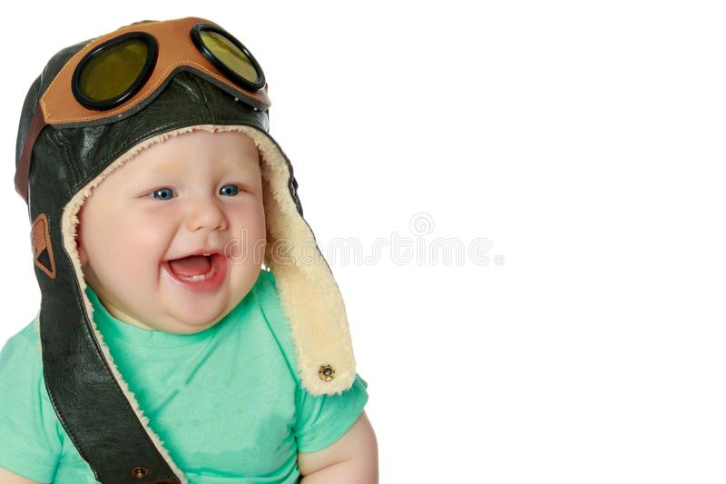 Cute little boy in helmet pilot. royalty free stock image