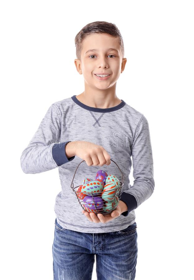 Cute little boy holding basket with Easter eggs on white background stock photos
