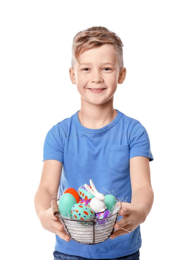 Cute little boy holding basket with Easter eggs on white background royalty free stock images