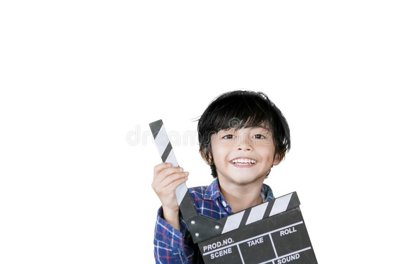 Cute little boy holding a clapperboard on studio stock images