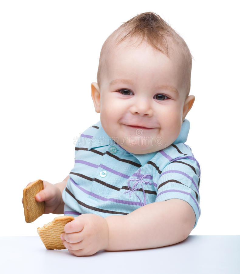 Cute little boy is holding cookies and smile royalty free stock photo