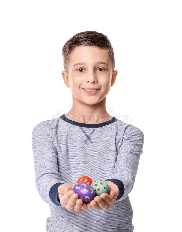 Cute little boy holding Easter eggs on white background royalty free stock photography