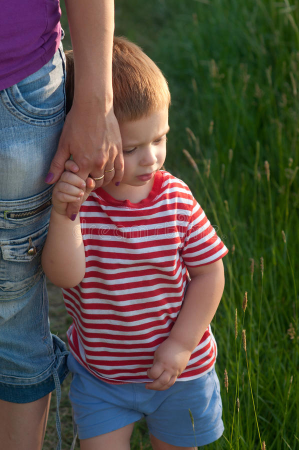 Cute Little Boy Holding Hand Of His Mother Stock Photo