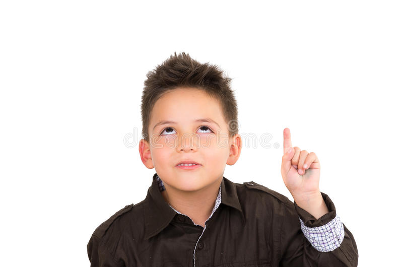 Cute little boy with an idea pointing up, isolated. Over white background royalty free stock photography