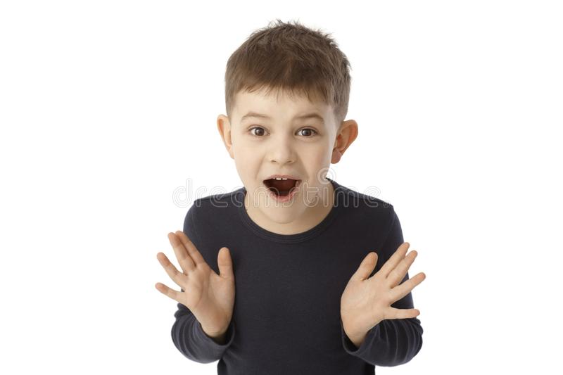 Cute little boy looking surprised royalty free stock photos