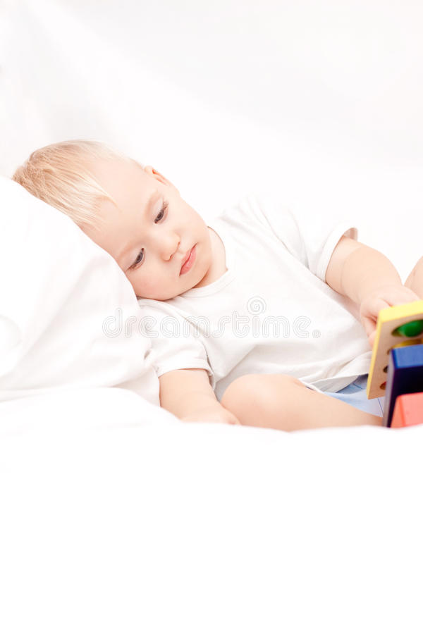 Download Cute Little Boy Lying On The Bed Stock Image - Image of caucasian, little: 11901905