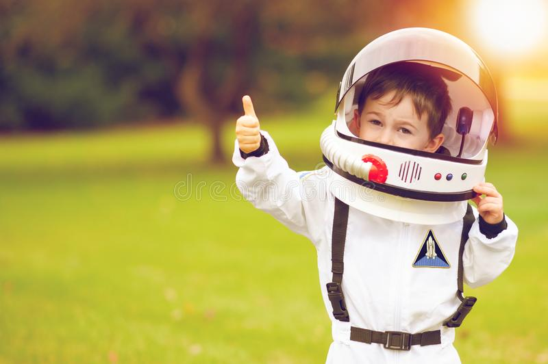 Cute little boy playing astronaut stock images