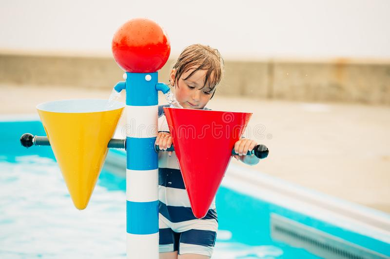 Cute little boy playing in baby pool stock photo