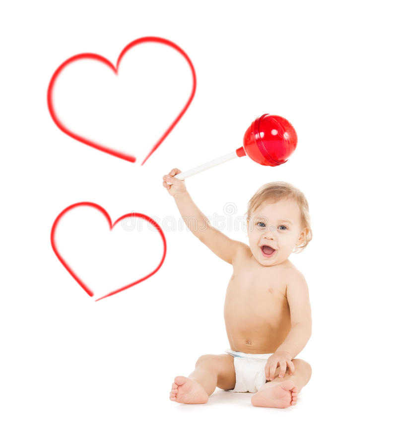 Cute little boy playing with big lollipop stock photography