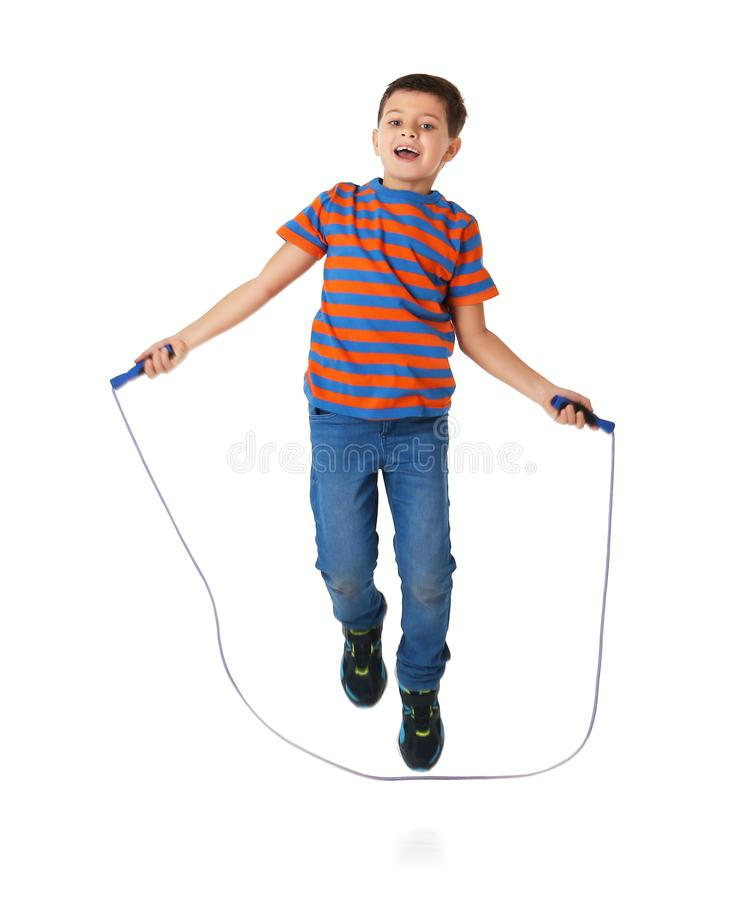 Cute little boy playing with jumping rope. On white background stock photos