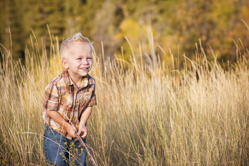 Download Cute Little Boy Playing Outdoors Stock Image - Image of playing, kids: 22719997