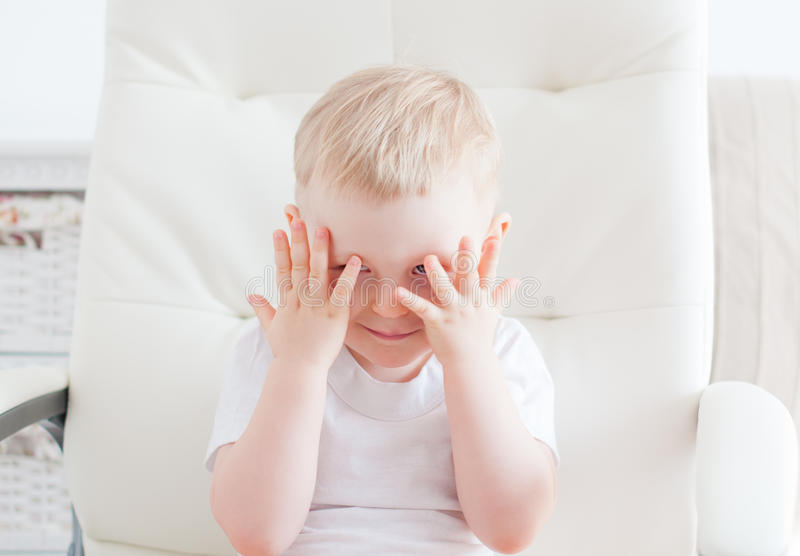 Little cute boy is hiding royalty free stock images