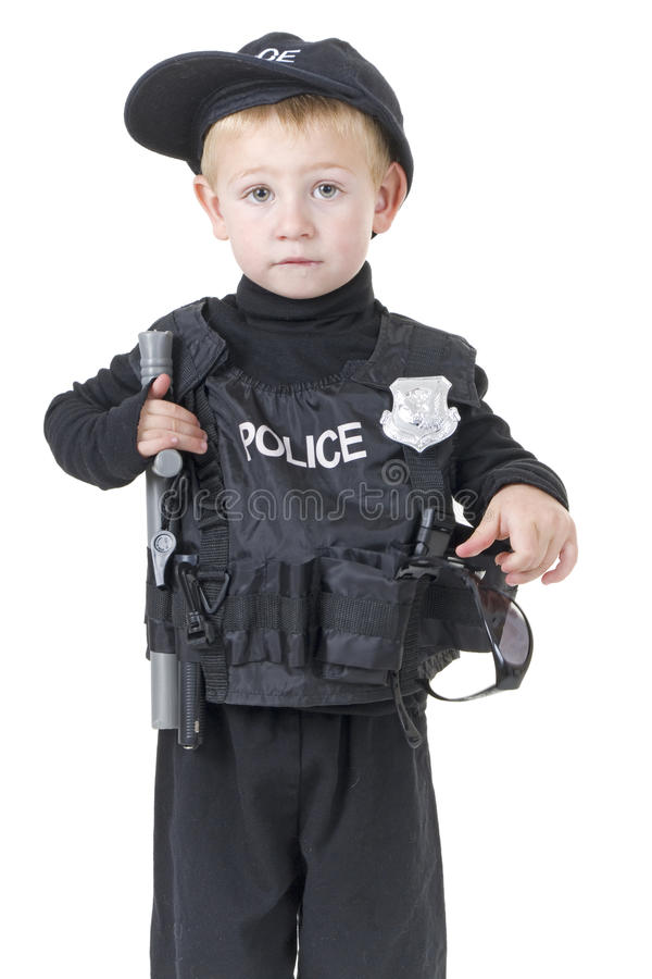 Cute little boy in policemans outfit stock images