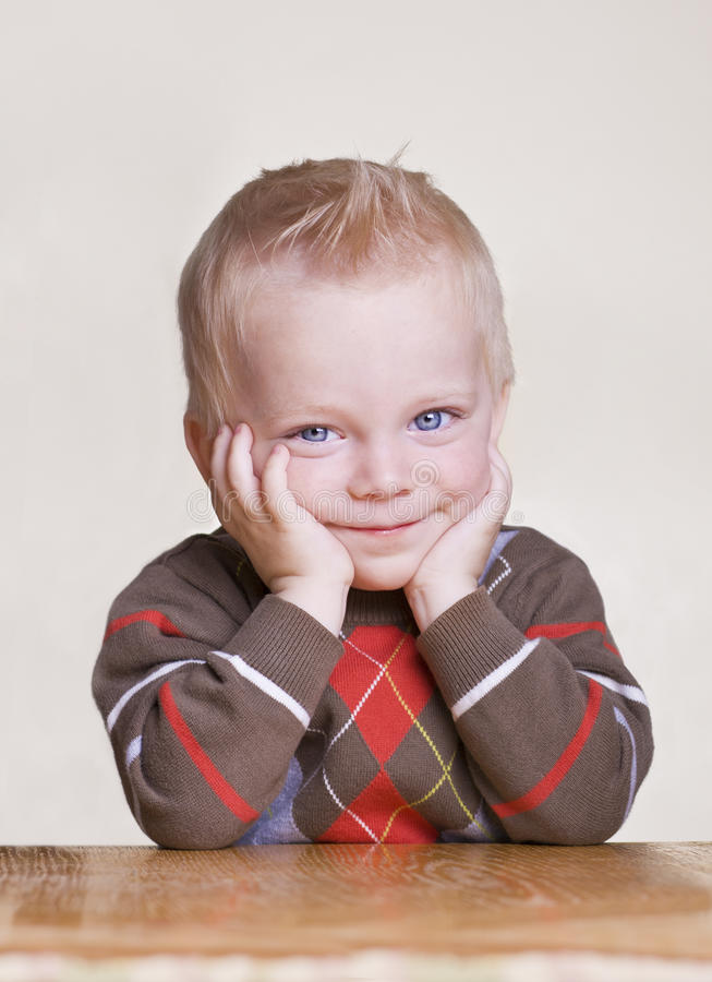 Cute little boy portrait with bored expression royalty free stock photography