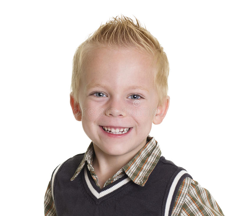 Cute Little Boy Portrait isolated on white. A head and shoulders photo of a cute, smiling little boy. Isolated on a white background stock image