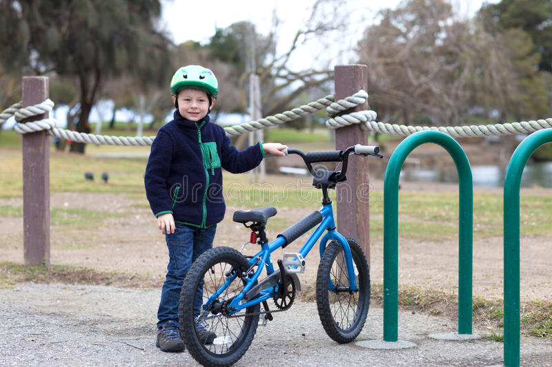 Cute little boy posing with his bike royalty free stock photography