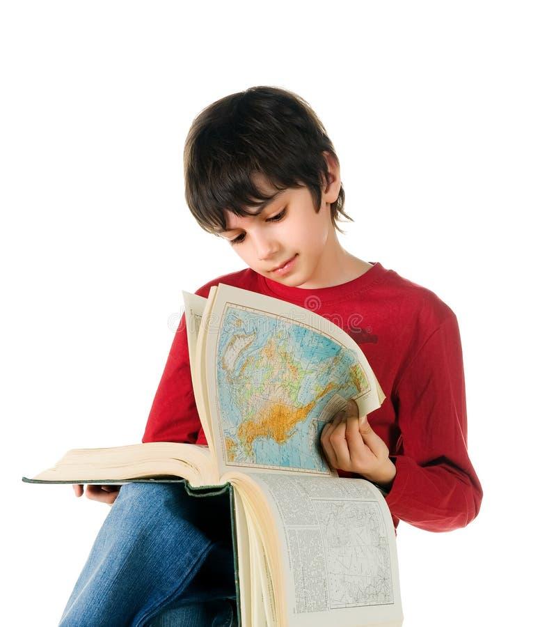 Cute little boy read a big book stock images