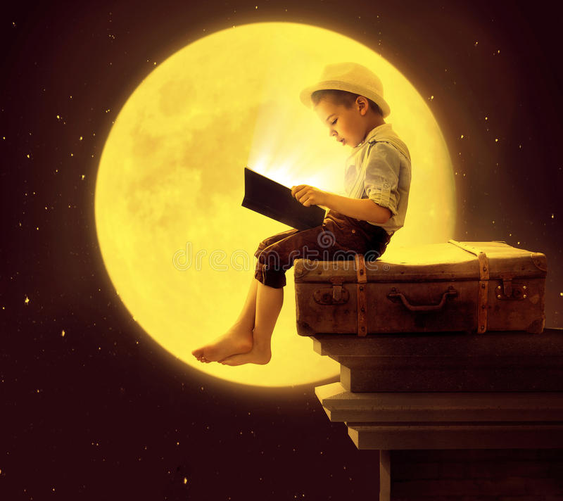 Free Cute Little Boy Reading A Book In The Moon Light Stock Images - 56419914
