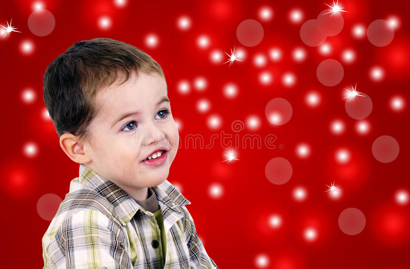 Download Cute Little Boy On Red Background With Lights Stock Photo - Image: 21978378