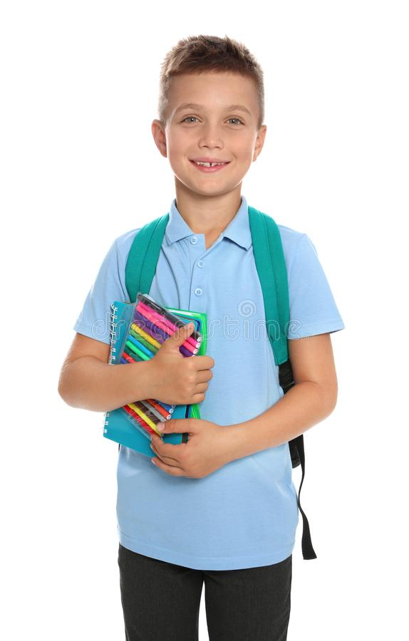 Cute little boy in school  with backpack and stationery on white background royalty free stock photo