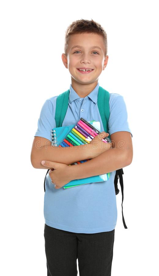 Cute little boy in school uniform with  and stationery on white background royalty free stock photography