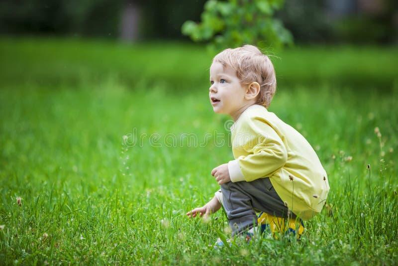 Cute little boy sitting on a ball stock photos