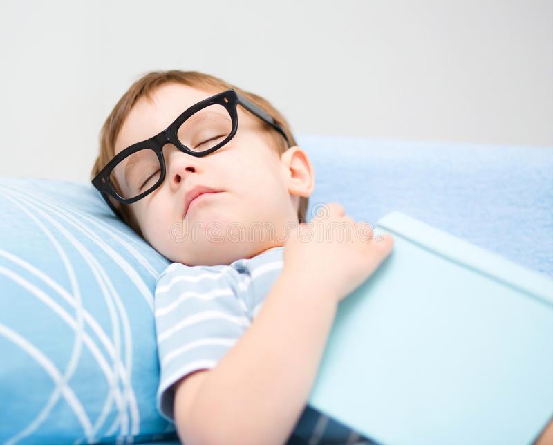 Cute little boy is sleeping stock image