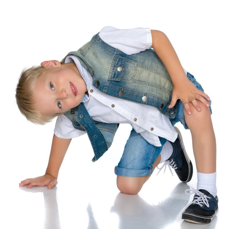 The little boy squatted down. stock photo