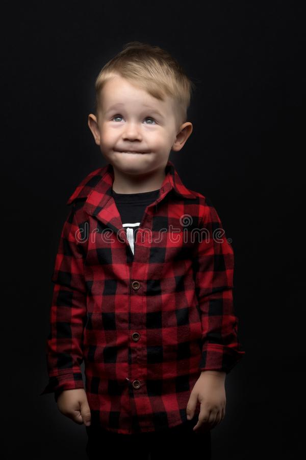 Little boy on a black background. royalty free stock image