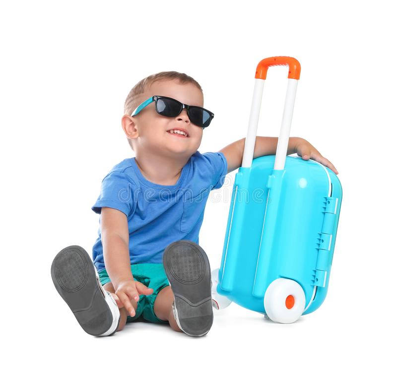 Cute little boy with sunglasses and blue suitcase royalty free stock images