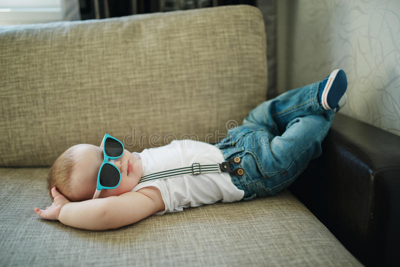 Cute little boy in sunglasses royalty free stock photos